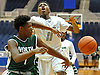 Travis Robinson-Morgan #11 of Elmont, right, tries to draw a foul on Taliq Abdul-Rahim #1 of Valley Stream North during the Nassau County varsity boys basketball Class A semifinals at Hofstra University on Wednesday, Feb. 24, 2016. Elmont won by a score of 77-54.