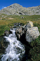 Small waterfall flowing from a rocky mountain.