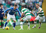 Celtic v St Johnstone...29.08.15  SPFL   Celtic Park<br /> Michael O'Halloran is closed down by Emilio Izaguiree<br /> Picture by Graeme Hart.<br /> Copyright Perthshire Picture Agency<br /> Tel: 01738 623350  Mobile: 07990 594431