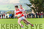 Daingean Uí Chúis Conor Ó Géibheannaigh in possession of the ball closely watched by an Ghaeltacht Cian Ó Murchú during the West Kerry Senior Championship Final at Pairc an Aghasaigh, Dingle, on Sunday afternoon.