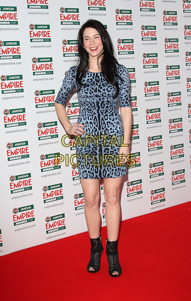 LYNN COLLINS.The Jameson Empire Film Awards, Grosvenor House Hotel, Park Lane, London, England..March 28th 2010.full length black leopard animal print dress hand on hip black ankle boots peep toe cage shooboots .CAP/ROS.©Steve Ross/Capital Pictures..