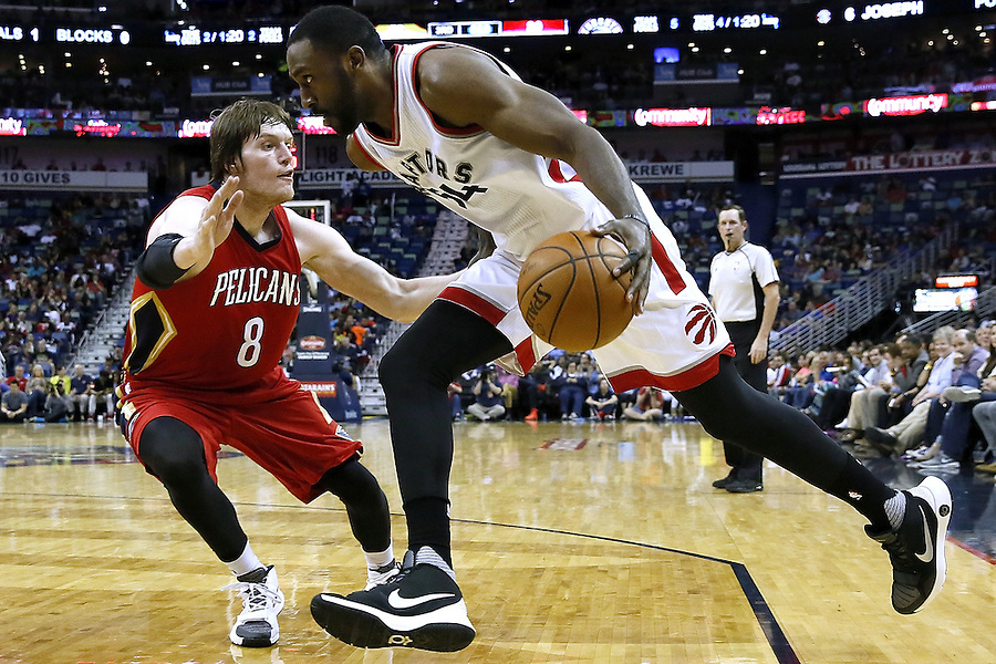 NEW ORLEANS, LA - MARCH 26: Patrick Patterson #54 of the Toronto Raptors drives against Luke Babbitt #8 of the New Orleans Pelicans during the second half of a game at the Smoothie King Center on March 26, 2016 in New Orleans, Louisiana. The Raptors won 115-91. NOTE TO USER: User expressly acknowledges and agrees that, by downloading and or using this photograph, User is consenting to the terms and conditions of the Getty Images License Agreement.  (Photo by Jonathan Bachman/Getty Images)