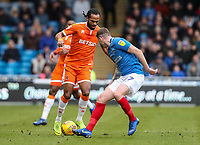 Blackpool's Nathan Delfouneso competing with Portsmouth's Dion Donohue<br /> <br /> Photographer Andrew Kearns/CameraSport<br /> <br /> The EFL Sky Bet League One - Portsmouth v Blackpool - Saturday 12th January 2019 - Fratton Park - Portsmouth<br /> <br /> World Copyright © 2019 CameraSport. All rights reserved. 43 Linden Ave. Countesthorpe. Leicester. England. LE8 5PG - Tel: +44 (0) 116 277 4147 - admin@camerasport.com - www.camerasport.com
