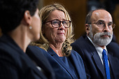UNITED STATES - SEPTEMBER 27: Christine Blasey Ford, center, flanked by attorneys Debra Katz and Michael Bromwich, testifies during the Senate Judiciary Committee hearing on the nomination of Brett M. Kavanaugh to be an associate justice of the Supreme Court of the United States, focusing on allegations of sexual assault by Kavanaugh against Christine Blasey Ford in the early 1980s. (Photo By Tom Williams/CQ Roll Call/POOL)
