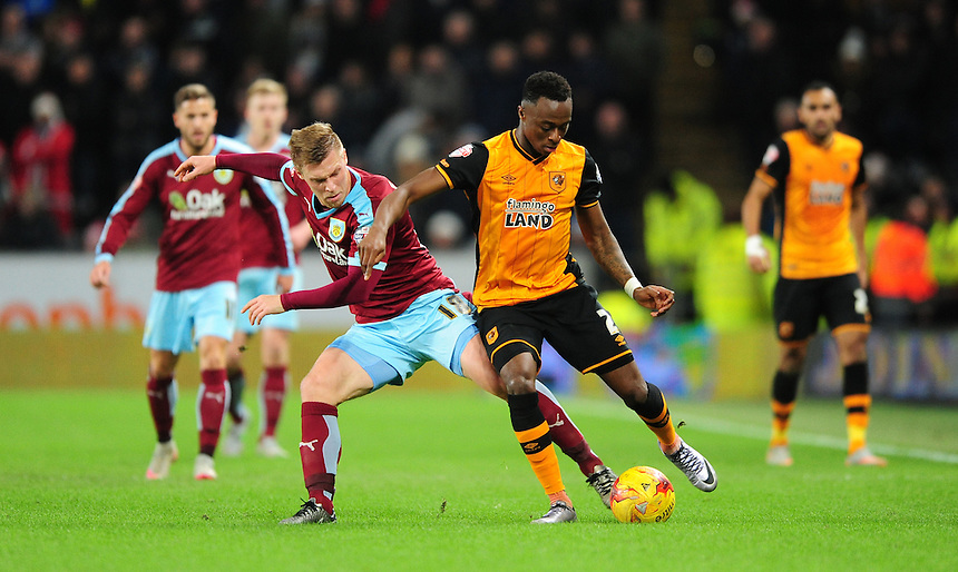 Burnley&rsquo;s Rouwen Hennings vies for possession with Hull City&rsquo;s Moses Odubajo<br /> <br /> Photographer Chris Vaughan/CameraSport<br /> <br /> Football - The Football League Sky Bet Championship - Hull City v Burnley - Saturday 26th December 2015 - Kingston Communications Stadium - Hull<br /> <br /> &copy; CameraSport - 43 Linden Ave. Countesthorpe. Leicester. England. LE8 5PG - Tel: +44 (0) 116 277 4147 - admin@camerasport.com - www.camerasport.com
