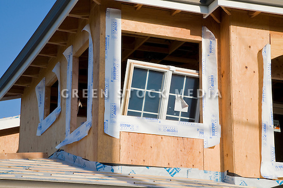 A close up of a window waiting to be placed in its frame at this residential construction project. Cupertino, California, USA