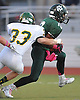 Justin Zotto #10 of Lindenhurst, right, tries to evade the tackle of Ryan McMullen #33 of Ward Melville during the first quarter of a Suffolk County Division I varsity football game against Ward Melville at Lindenhurst Middle School on Friday, Oct. 7, 2016. Zotto returned an interception 75 yards for a touchdown as time expired in the second quarter to give Lindenhurst a 16-7 lead at halftime.