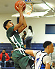 Camren Wynter #12 of Holy Trinity, left, looks to drive to the hoop during a varsity boys' basketball game against Hempstead at Baldwin High School on Tuesday, Dec. 29, 2015. Holy Trinity won by a score of 70-58.