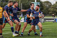 Ed Hoadley of London Scottish (right) celebrates after he scores a try during the Greene King IPA Championship match between London Scottish Football Club and Ealing Trailfinders at Richmond Athletic Ground, Richmond, United Kingdom on 8 September 2018. Photo by David Horn.