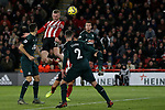 Oliver McBurnie of Sheffield United heads the ball at goal during the Premier League match at Bramall Lane, Sheffield. Picture date: 5th December 2019. Picture credit should read: James Wilson/Sportimage