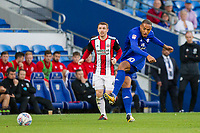 Kenneth Zohore of Cardiff City passes away from John Fleck of Sheffield United during the Sky Bet Championship match between Cardiff City and Sheffield United at Cardiff City Stadium, Cardiff, Wales on 15 August 2017. Photo by Mark  Hawkins / PRiME Media Images.