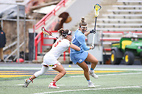 College Park, MD - February 24, 2019: Maryland Terrapins midfielder Jen Giles (5) pushes North Carolina Tar Heels Olivia Ferrucci (77) during the game between North Carolina and Maryland at  Capital One Field at Maryland Stadium in College Park, MD.  (Photo by Elliott Brown/Media Images International)