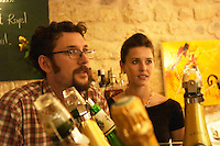 The gourmet Restaurant Le Jardin d'Ausone in the old town in Bordeaux: the bar with Laurent Vialette and his wife - owner of the restaurant.