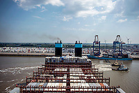Tugs pull the Mary Maersk, the largest container ship in the world, into position as it arrives at Bremerhaven.
