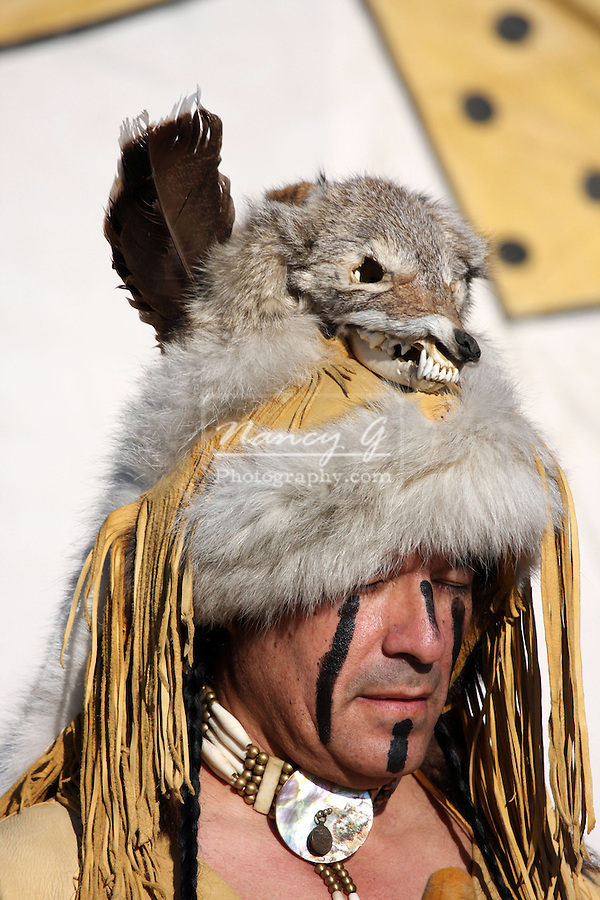 Apache Native American Indian with a animal fur hat or headdress