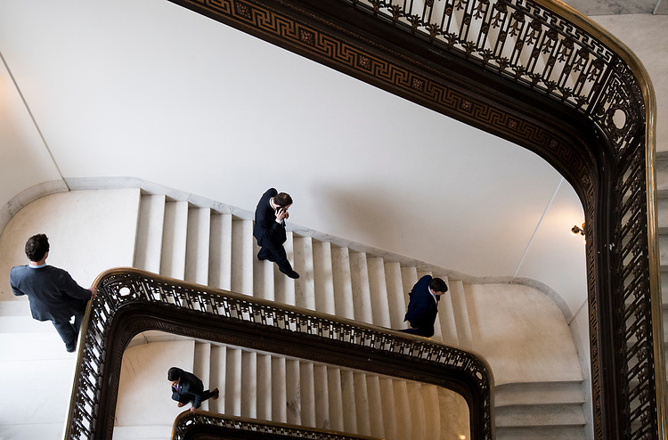 UNITED STATES - MARCH 12: Senate staffers use the stairs in the Russell Senate Office Building on Monday, March 12, 2018. (Photo By Bill Clark/CQ Roll Call)