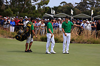 Adam Hadwin and Joaquin Niemann (International) on the 1st green during the Second Round - Foursomes of the Presidents Cup 2019, Royal Melbourne Golf Club, Melbourne, Victoria, Australia. 13/12/2019.<br /> Picture Thos Caffrey / Golffile.ie<br /> <br /> All photo usage must carry mandatory copyright credit (© Golffile | Thos Caffrey)