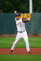 Cedar Rapids Kernels second baseman Rafael P Valera (17) warmup throw to first during a game against the Kane County Cougars on August 18, 2015 at Perfect Game Field in Cedar Rapids, Iowa.  Kane County defeated Cedar Rapids 1-0.  (Mike Janes/Four Seam Images)