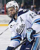 Spencer Abbott (Maine - 13) - The University of Maine Black Bears defeated the University of New Hampshire Wildcats 5-4 in overtime on Saturday, January 7, 2012, at Fenway Park in Boston, Massachusetts.