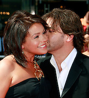 US TV chef Rachael Ray gets a kiss from her husband John Cusimano as she arrives at the 35th Annual Daytime Emmy Awards held at the Kodak Theatre in Los Angeles on June 20, 2008.