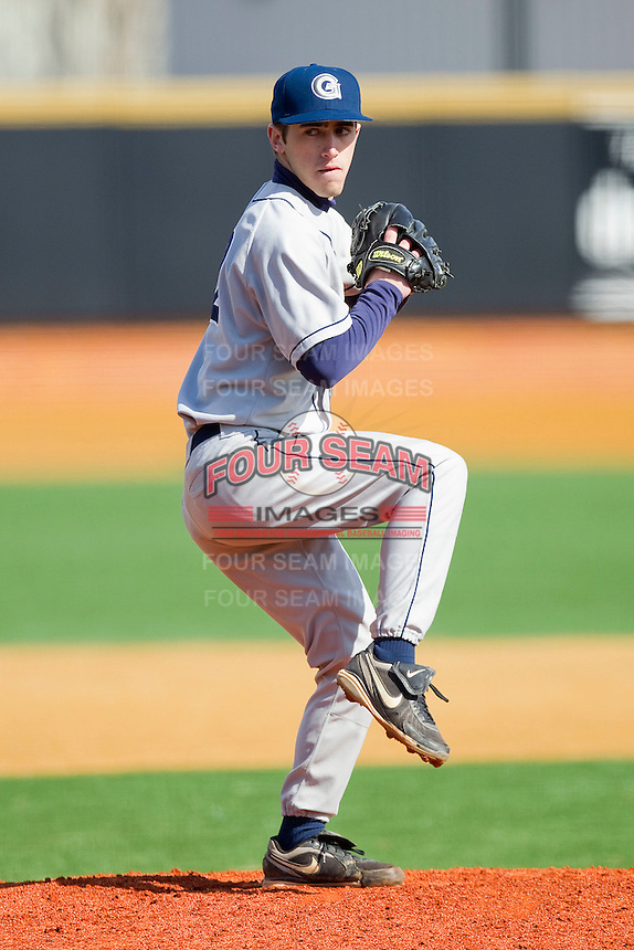 Relief pitcher Thomas Polus #22 of the Georgetown Hoyas in action against the Delaware State Hornets at Gene Hooks Field on February 26, 2011 in Winston-Salem, North Carolina.  Photo by Brian Westerholt / Four Seam Images
