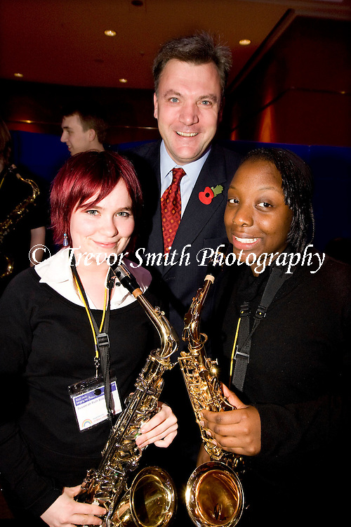 Ed Balls MP with two young musicians