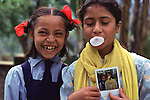 Nepali girls enjoying a polaroid photo