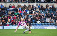 Sam Togwell of Barnet clears from Marcus Bean of Wycombe Wanderers during the Sky Bet League 2 match between Wycombe Wanderers and Barnet at Adams Park, High Wycombe, England on 16 April 2016. Photo by Andy Rowland.