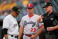 Sean Williams during the lineup exchange with umpire Thomas Roche and Rouglas Odor (left) before an Eastern League game between the Reading Fightin Phils and Akron RubberDucks on June 4, 2019 at Canal Park in Akron, Ohio.  Akron defeated Reading 8-5.  (Mike Janes/Four Seam Images)