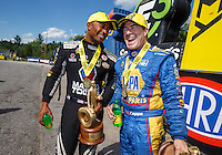 Jun 6, 2016; Epping , NH, USA; NHRA top fuel driver Antron Brown (left) celebrates with funny car driver Ron Capps after winning the New England Nationals at New England Dragway. Mandatory Credit: Mark J. Rebilas-USA TODAY Sports