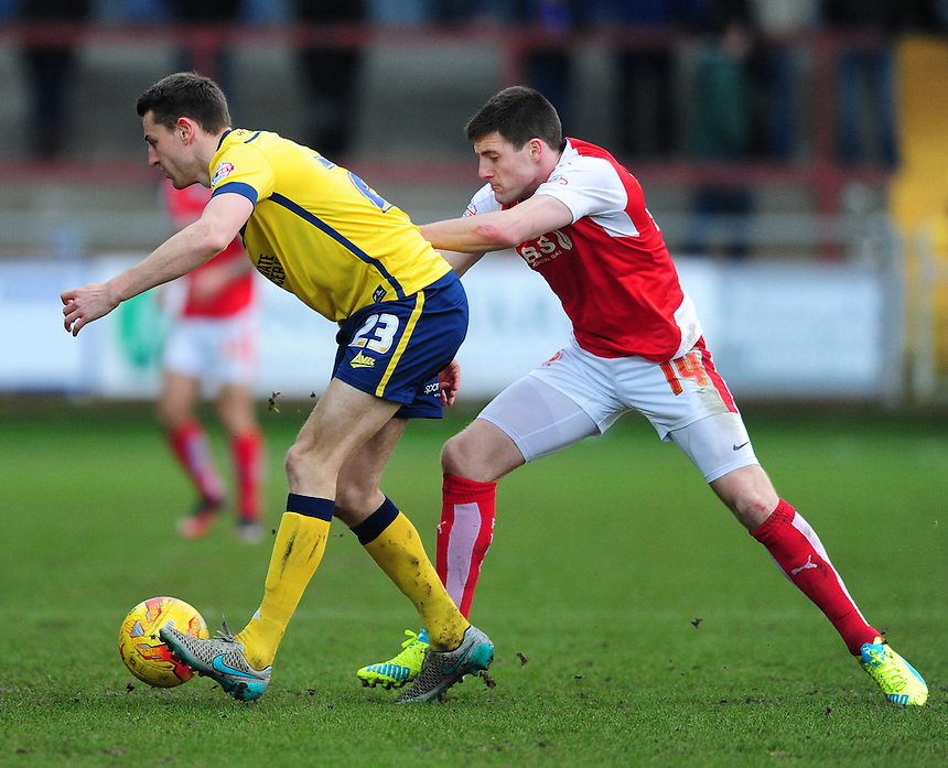 Fleetwood Town's Bobby Grant vies for possession with Scunthorpe United&rsquo;s Murray Wallace<br /> <br /> Photographer Chris Vaughan/CameraSport<br /> <br /> Football - The Football League Sky Bet League One - Fleetwood Town v Scunthorpe United  - Saturday 20th February 2016 - Highbury Stadium - Fleetwood    <br /> <br /> &copy; CameraSport - 43 Linden Ave. Countesthorpe. Leicester. England. LE8 5PG - Tel: +44 (0) 116 277 4147 - admin@camerasport.com - www.camerasport.com