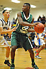 Derick Eugene #22 of Holy Trinity, right, looks to pass away from Durell Williams #11 of Hempstead during a varsity boys' basketball game at Baldwin High School on Tuesday, Dec. 29, 2015. Holy Trinity won by a score of 70-58.