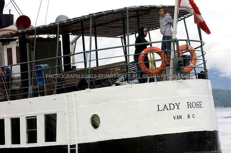 8/11/2007--Bamfield, British Columbia, Canada  The 'Lady Rose' arrives at Bamfield after a 3 hour journey from Port Alberni. The ship which now ferries tourists, locals as well as supplies to Bamfield, was built in 1937 in Glasgow, Scotland..Bamfield, British Columbia, on Canada's Pacific Northwest coast on Vancouver Island, was a key station on the fragile line of telegraph cables that kept London talking to its farthest-flung imperial outposts around the world. The heart of Bamfield is a collection of old fisherman's homes and piers, with a broadwalk that allows visitors to stroll along the waterfront. Kayaks, canoes and small motorboats are the main form of transportation across the inlet. .Today, Bamfield remains as a cluster of charming wooden fishermen?s houses and a few bed and breakfasts for the adventurous traveler, around a bay formed by two tiny peninsulas of cliffs that protect the village from fierce winter storms. Originally settled by the Huu-ay-aht First Nation, sits quietly south of the the more popular and booming tourist towns of Tofino and Ucluelet.©2007 Stuart Isett. All rights reserved