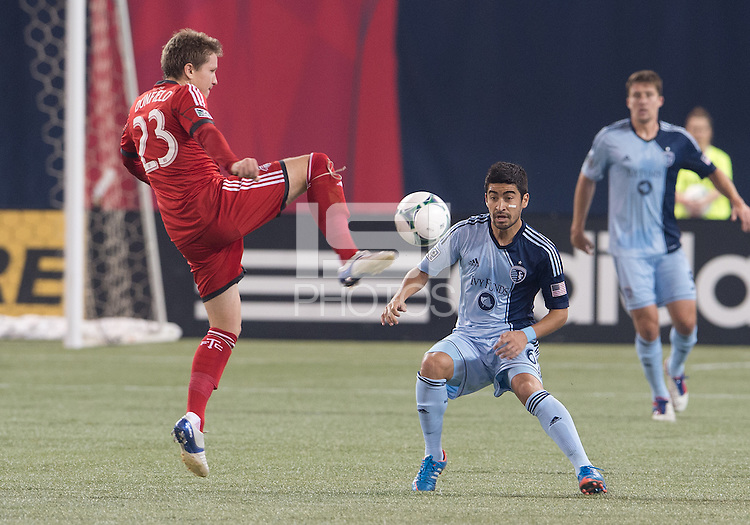 March 9, 2013: Toronto FC midfielder Terry Dunfield #23 and Sporting KC midfielder Paulo Nagamura #6 in action during a game between Toronto FC and Sporting Kansas City at the Rogers Centre in Toronto, Ontario Canada..Toronto FC won 2-1.