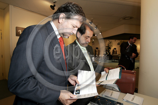 BRUSSELS - BELGIUM - 25 APRIL 2006 -- Marcelino Iglesias RICOU (Le), President of the Government of the Aragon Region (Spain) with J. Velasco RODRIGUES, Minister of Transport of the Government of the Aragon Region and Mateo SIERRA looking at brochures before the meeting of 100 logistical Platforms in the EU-Commission. -- PHOTO: JUHA ROININEN / EUP-IMAGES.