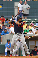 Catcher Luis Exposito of the Salem Red Sox hittingagainst  the Myrtle Beach Pelicans on May 3, 2009