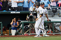 Vanderbilt Commodores outfielder Jeren Kendall (3) is greeted by third base coach Tim Corbin (4) after his walk off 2 run home run during the NCAA College baseball World Series against the Cal State Fullerton Titans on June 15, 2015 at TD Ameritrade Park in Omaha, Nebraska. Vanderbilt beat Cal State Fullerton 4-3. (Andrew Woolley/Four Seam Images)