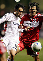 Real Salt Lake midfielder Fabian Espindola (18) and Chicago Fire defender Wilman Conde (22) battle for the ball.  Real Salt Lake defeated the Chicago Fire in a penalty kick shootout 0-0 (5-4 PK) in the Eastern Conference Final at Toyota Park in Bridgeview, IL on November 14, 2009.
