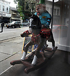 """A view of """"Clownin Around"""" created by, Alan Ward, in window of the former 'Boudoir & Baby' shop at 114 Partition Street, one of the """"Rockin' Around Saugerties"""" theme Statues on display throughout the Village of Saugerties, NY, on Friday, June 9, 2017. Photo by Jim Peppler. Copyright/Jim Peppler-2017."""