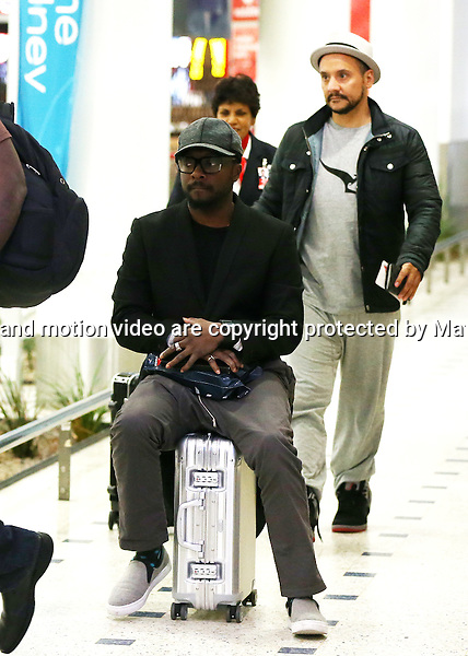 5 JULY 2014 SYDNEY AUSTRALIA<br /> <br /> NON EXCLUSIVE <br /> <br /> Will.i.am pictured rolling into Sydney on his suitcase at Sydney International Airport  <br /> <br /> *No internet without clearance*.<br /> MUST CALL PRIOR TO USE <br /> +61 2 9211-1088. <br /> <br /> Matrix Media Group.Note: All editorial images subject to the following: For editorial use only. Additional clearance required for commercial, wireless, internet or promotional use.Images may not be altered or modified. Matrix Media Group makes no representations or warranties regarding names, trademarks or logos appearing in the images.