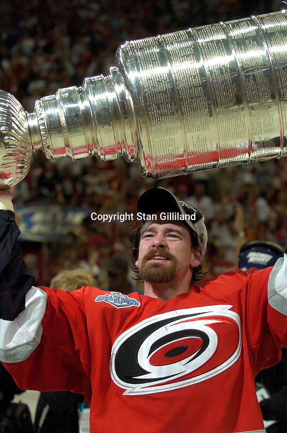Justin Williams holds the Stanley Cup after the Carolina Hurricanes beat the Edmonton Oilers 3-1 in game seven to win the series at the RBC Center in Raleigh, NC Monday, June 19, 2006.