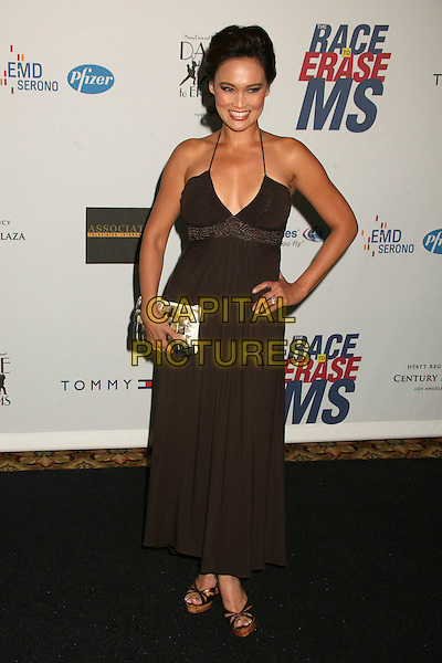 "TIA CARRERE .14th Annual Race to Erase MS Themed ""Dance to Erase MS"" at the Century Plaza Hotel, Century City, California, USA, 13 April 2007..full length brown halterneck dress hand on hip.CAP/ADM/BP.©Byron Purvis/AdMedia/Capital Pictures."