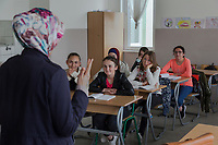 Serbia. Veliki Trnovac (in Albanian: Tërnoc i Madh) is a town in the municipality of Bujanovac, located in the Pčinja District of southern Serbia. « Muharrem Kadriu » Elementary School. The school's students are all from Albanian ethnicity. Classroom. 7th Grade. A teacher talks to her students during a religion class. The schoolteacher wears a hijab while her pupils are dressed according to the western dress code. A hijab is a veil worn by some Muslim women in the presence of any male outside of their immediate family, which usually covers the head and chest. Bujanovac is located in the geographical area known as Preševo Valley. The Pestalozzi Children's Foundation (Stiftung Kinderdorf Pestalozzi) is advocating access to high quality education for underprivileged children. It supports in Bujanovac a project called » Our towns, our schools ». 16.4.2018 © 2018 Didier Ruef for the Pestalozzi Children's Foundation