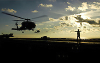 Recovering helicopters aboad USS Abraham Lincoln.