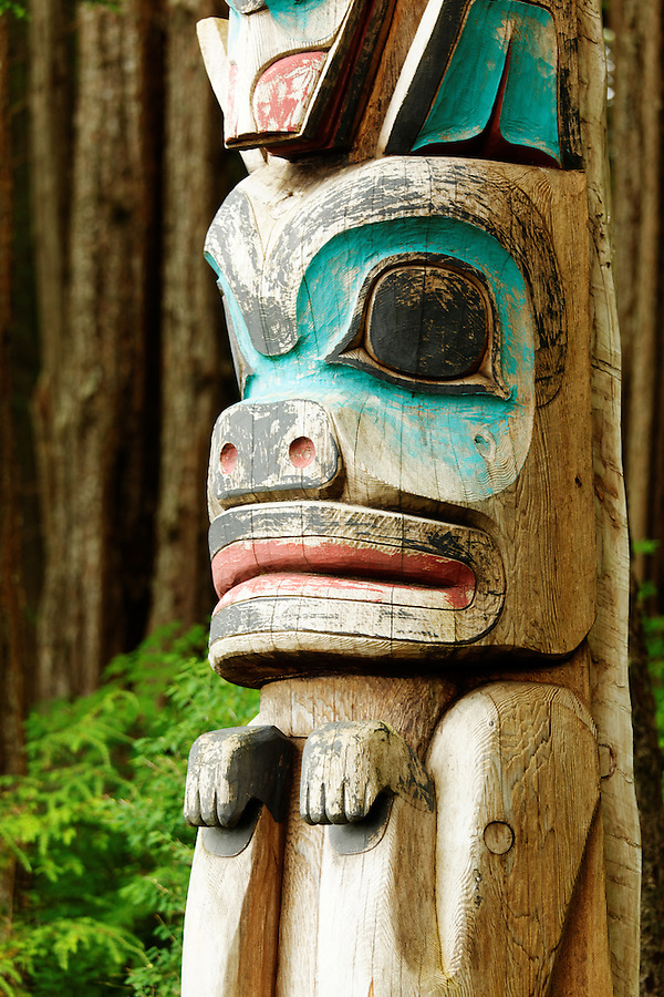 Bear carved at base of Raven/Shark totem pole, Sitka National Historical Park, Sitka, Alaska, USA