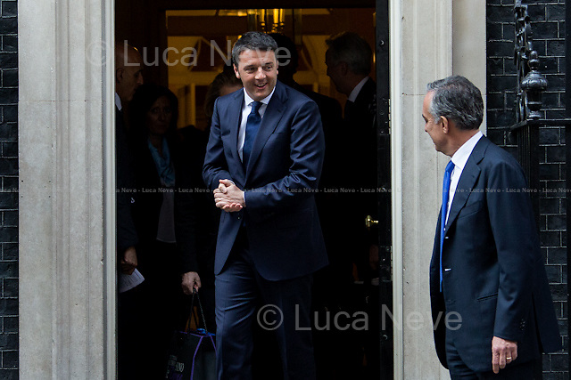 (From L to R) Matteo Renzi (Italian Prime Minister) &amp; Pasquale Terracciano (Italian Ambassador in the UK). <br /> <br /> London, 01/04/2014. The new Italian Prime Minister, Matteo Renzi, visited 10 Downing Street where he had a meeting with the British Prime Minister David Cameron. Noticeably, the Italian Prime Minister used a different car for his official visit in the UK. In fact, this time the official Maserati Quattroporte &quot;Ita 1&quot;, was replaced by a Chrysler 300c, car produced by the new FAC, Fiat Chrysler Automobiles, which moved its new holding company incorporated just yesterday from Italy (Historical base of FIAT - Fabbrica Italiana Automobili Torino) to the Netherlands, with tax domicile in the United Kingdom.