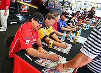 Jun 11, 2016; Englishtown, NJ, USA; NHRA funny car driver Cruz Pedregon signs autographs during qualifying for the Summernationals at Old Bridge Township Raceway Park. Mandatory Credit: Mark J. Rebilas-USA TODAY Sports