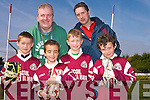 Cromane GAA are kick-staring a novel scheme to help parents save money by organising to recycle children's football boots. .Back L-R Cromane GAA Bord Na No?g Secretary Rob O'Neill and U8/U10 trainer Colin O'Sullivan. .Front L-R Kieran O'Sullivan, Oisin Palmer, Jack O'Sullivan and Darragh McKeefry