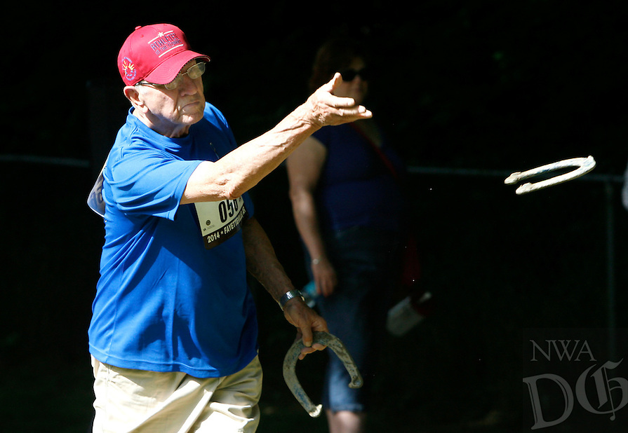 NWA Media/DAVID GOTTSCHALK - 6/30/14 - Ted, Czalpla, 82, makes a pitch Monday June 30, 2014 at Walker Park in Fayetteville during competition in the 80-84 year old horse shoe division of play at the 28th annual National Veterans Golden Age Games. Czalpla, of St. Louis, Mo., won the gold medal in his division.
