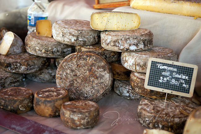 A stack of local artisan made cheeses in Gordes, France
